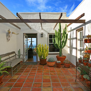 Inspiration for a southwestern courtyard patio remodel in Orange County