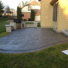 Traditional Patio by Two Brothers Brick Paving