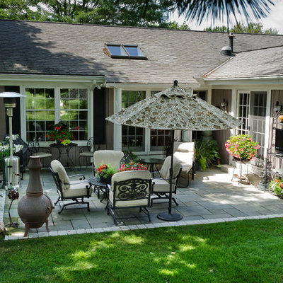 Inspiration for a mid-sized transitional backyard stone patio remodel in Milwaukee
