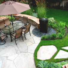 Traditional Patio by Darwin Webb Landscape Architects, P.S.