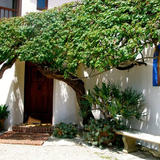 This is an example of a mediterranean patio in Santa Barbara with decomposed granite.