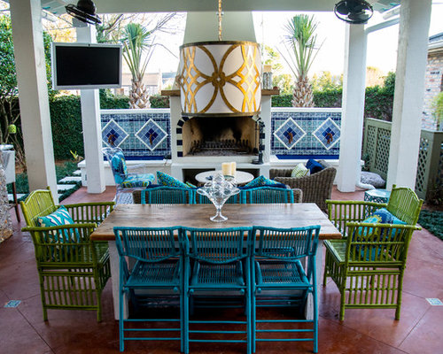Example Of A Coastal Patio Design In New Orleans With A Fire Pit And A  Gazebo
