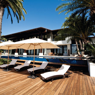 Inspiration for a tropical patio remodel in Miami with decking