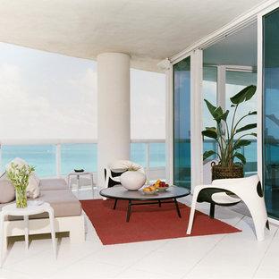 Idées déco pour une terrasse contemporaine avec une extension de toiture.