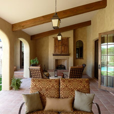 Mediterranean Patio by Pentimento Lighting and Furnishings