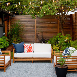 Inspiration for a small 1950s courtyard stone patio remodel in Seattle with no cover