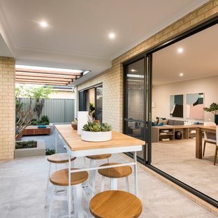 Inspiration for a contemporary backyard patio in Perth with tile and a roof extension.