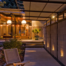Midcentury Exterior by Pearson Design Group
