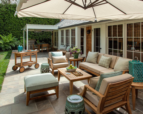 Large Transitional Backyard Stone Patio Idea In Los Angeles