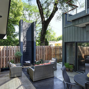 Example of a large trendy courtyard concrete patio design in Milwaukee with a fire pit and no cover