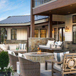 Example Of A Country Patio Design In Salt Lake City With Fire Pit And