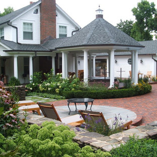 Example of a classic patio design in Chicago with a gazebo