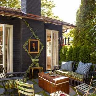 Design ideas for a small victorian patio in San Francisco with concrete pavers and no cover.