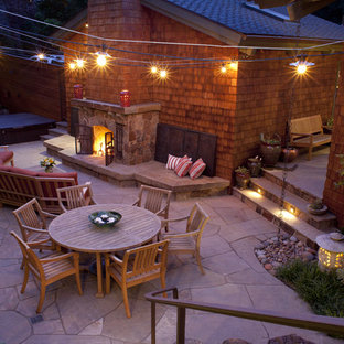 Traditional patio in San Francisco with natural stone pavers and a fire feature.