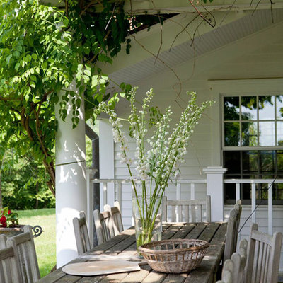 Inspiration for a timeless side yard patio remodel in New York with a pergola