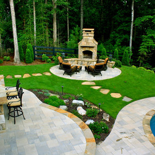 Mid-sized elegant backyard concrete paver patio photo in Atlanta with a fire pit and no cover