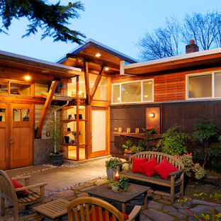 Inspiration for a large contemporary front yard stone patio remodel in Seattle