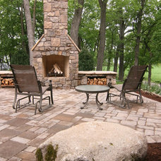 Rustic Patio by yardscapes Inc.