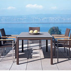Mocca Wicker Dining Collection - Mocca colored outdoor wicker dining table and chairs.