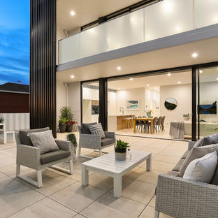 Design ideas for a modern patio in Sydney with no cover and concrete pavers.