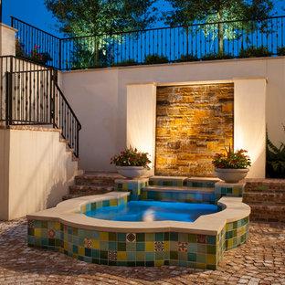 Mid-sized tuscan courtyard brick patio fountain photo in Dallas