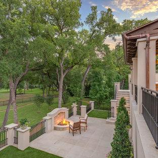 Patio - mediterranean patio idea in Dallas with a fire pit