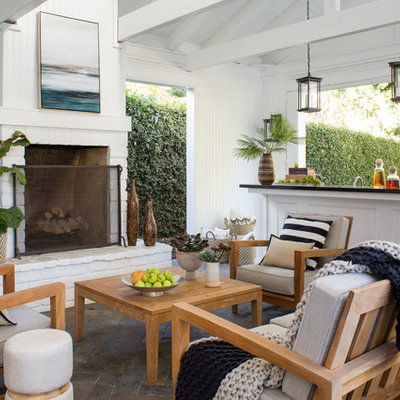 Patio - mid-sized transitional stone patio idea in Los Angeles with a roof extension