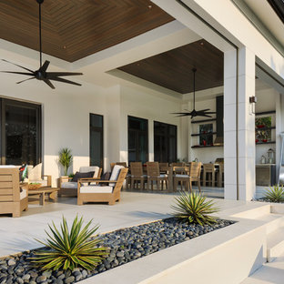 Inspiration for a large modern backyard tile patio kitchen remodel in Miami with a roof extension