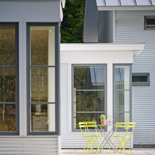 Example of a mid-sized cottage backyard patio design in Burlington with no cover