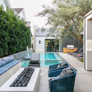 Inspiration for a contemporary backyard tile patio remodel in Orange County with a fire pit