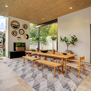 Inspiration For A Contemporary Backyard Tile Patio Remodel In Houston With  A Fireplace And A Roof