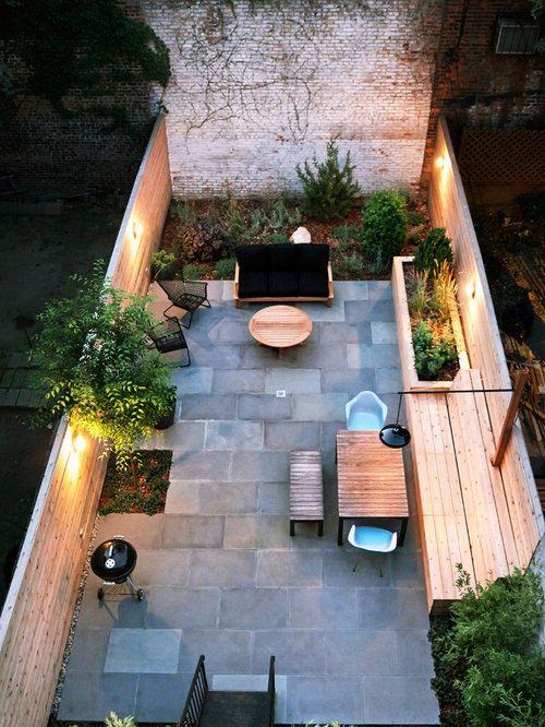 Example Of A Small Trendy Backyard Stone Patio Design In New York