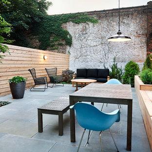 Idée de décoration pour une terrasse design avec aucune couverture.