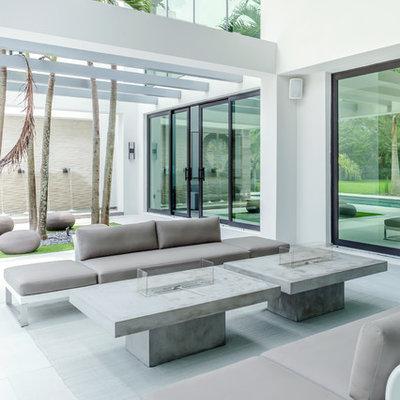 Example of a trendy patio design in Miami with a pergola