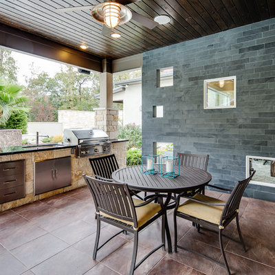 Mid-sized elegant backyard tile patio photo in Houston with a roof extension