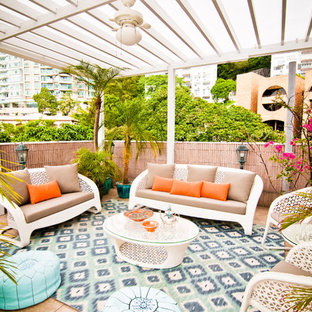 Inspiration for a tropical patio remodel in Nashville with a pergola