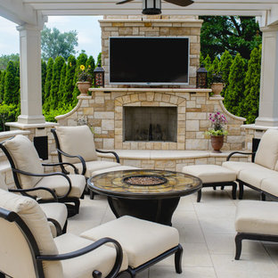 This is an example of a mediterranean patio in New York with a pergola.