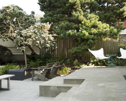 Contemporary Concrete Patio Idea In Portland With A Fire Pit