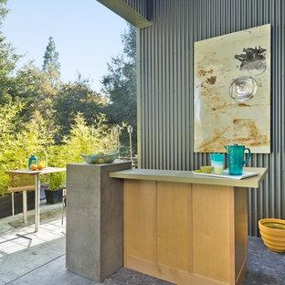 Patio - contemporary concrete patio idea in San Francisco