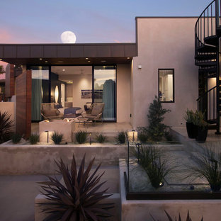 Patio - southwestern backyard concrete patio idea in San Diego with a fire pit and no cover