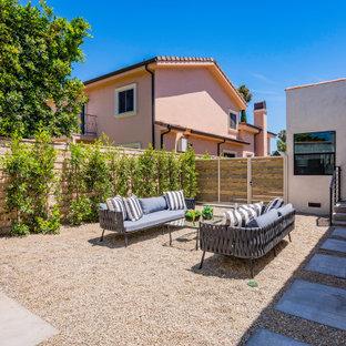 Patio - mediterranean gravel patio idea in Los Angeles with no cover