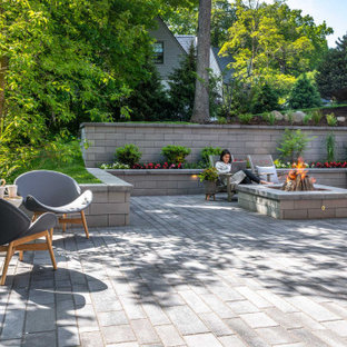 Patio - transitional backyard concrete paver patio idea in Other with a fire pit and no cover