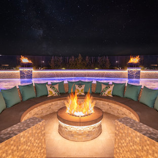 Patio - contemporary backyard tile patio idea in Orange County with a fire pit and no cover