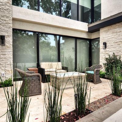 Patio - mid-sized contemporary concrete paver patio idea with no cover
