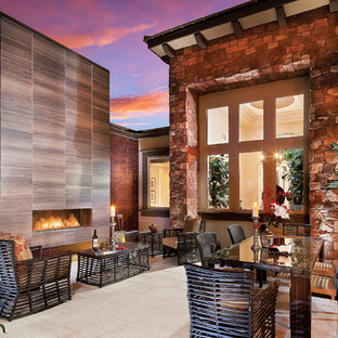 Large southwest tile patio photo in Las Vegas with no cover and a fireplace
