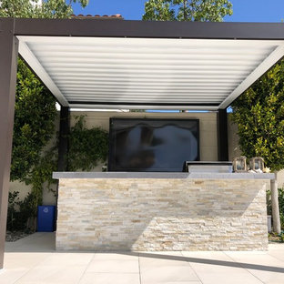 Photo of a medium sized contemporary back patio in Orange County with an outdoor kitchen, tiled flooring and a gazebo.