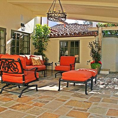 Inspiration for a mediterranean patio remodel in Santa Barbara with a pergola