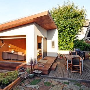 Photo of a medium sized modern courtyard patio in Seattle with decking, an outdoor kitchen and no cover.