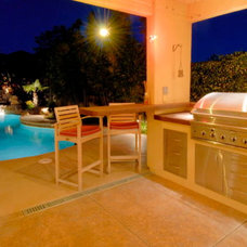 Tropical Patio by Morse Remodeling, Inc. and Custom Homes