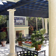 Mediterranean Patio by Blakely and Associates Landscape Architects, Inc.